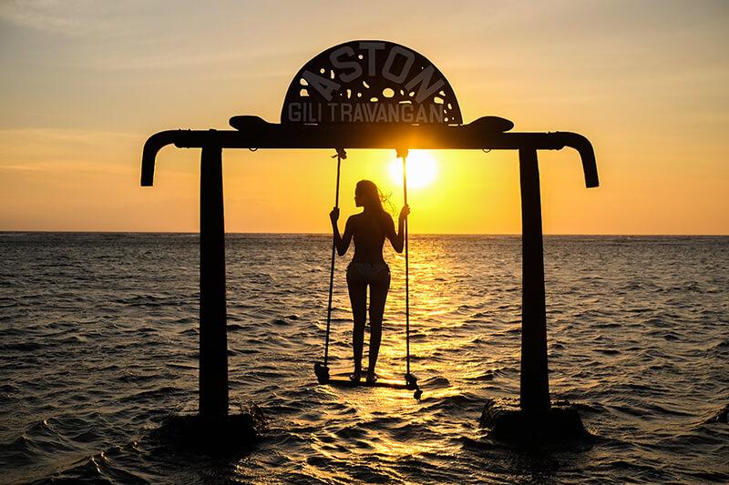 Silhouette of Beautifull Gate with girls swing Gili Trawangan